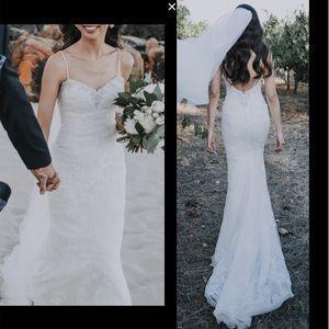 Backless Pronovias trumpet mermaid wedding dress
